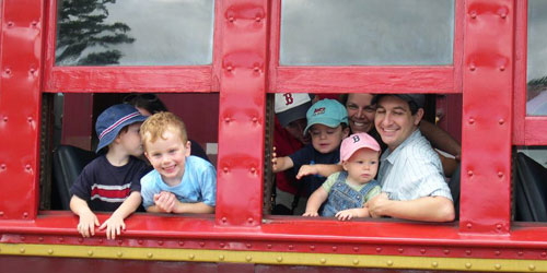 Kids in the Windows 500x250 - Conway Scenic Railroad - North Conway, NH
