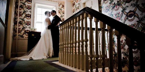 Wedding Top of Stairs 500x250 - Harbor Light Inn - Marblehead, MA - Photo Credit Melissa Coe
