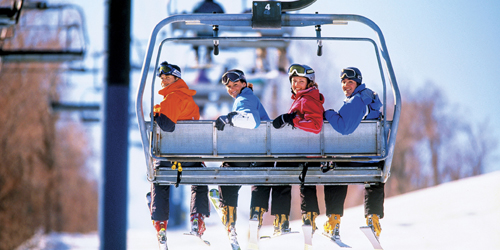 Winter in New England - Skiers on Chairlift at Wachusett Mountain in New Hampshire
