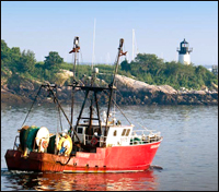New England fishing boat and lighthouse